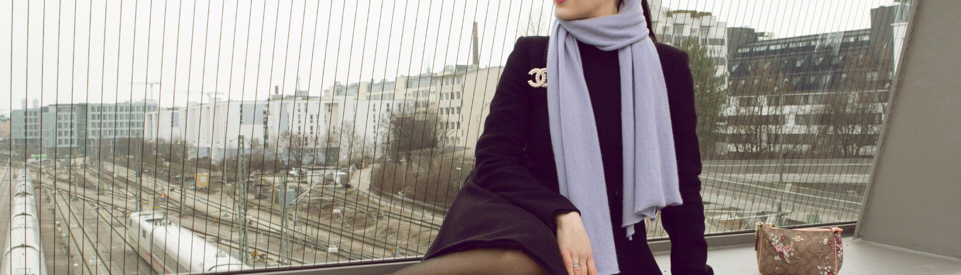 banner magic munich blog black winter coat